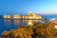 Aerial view of Aragonese Fortress exterior at sunset, Calabria,. Italy Royalty Free Stock Photography
