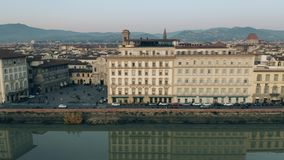 Aerial view of the Arno river embankment in the evening. Florence, Italy. Aerial view of the Arno river embankment in the evening stock video
