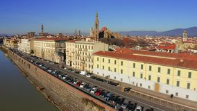 Aerial view of the Arno river embankment towards Florence Cathedral or Cattedrale di Santa Maria del Fiore. Italy. Aerial view of the Arno river embankment stock video footage