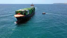 Aerial view of the arrival in the vicinity of the port of Alicante, the container ship JSP Rover.