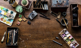 Aerial view of artistic euqipments painting tools on wooden table stock photo