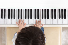Aerial view of Asian Chinese little boy playing piano Stock Photo