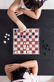 Aerial view of Asian Chinese little sisters playing chess togeth. Er in the living room at home Royalty Free Stock Photo