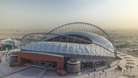 Aerial view of Aspire Zone stadium from at morning timelapse in Doha. Aerial view of Aspire Zone stadium from top at morning during sunrise timelapse in Doha stock video footage