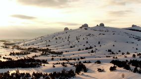 Aerial view of the astrophysical observatory in wintertime in snowy forest, Crimea. Shot. Beautiful landscape of snowy. Aerial view of the astrophysical royalty free stock images
