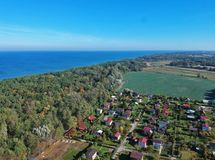 Free Aerial View At Landscape With Sea, Field, Forest And Small Village Buildings. Stock Photography - 129364262