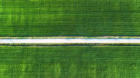 Aerial View At The Road And Field. Agricultural Landscape From Air. Field And Road. Farm At Summer Time. Drone Photography Stock Photo