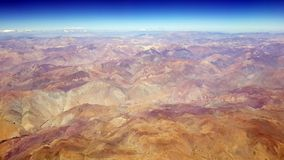 Aerial view of the Atacama desert and the Andean mountains, Chile. Aerial view of the Atacama desert and the Andean volcanoes from the airplane, Chile royalty free stock images