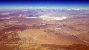 Aerial view of the Atacama desert and the Andean mountains, Chile. Aerial view of the Atacama desert and the Andean volcanoes from the airplane, Chile royalty free stock photos