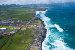 Aerial view of Atlantic coast at Ribeira Grande. Blue water and clouds. Island of Sao Miguel, Azores Islands, Portugal, Europe.  royalty free stock image