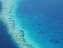 Aerial view of an atoll in Maldives with underwater coral reef Royalty Free Stock Images
