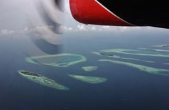 Aerial view of atolls from seaplane, Maldives stock photo