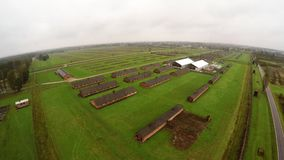 Aerial view of Auschwitz I - Birkenau, living quarters, watch tower and fence stock video