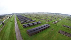 Aerial view of Auschwitz I - Birkenau, watch tower and fence stock footage