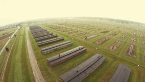 Aerial view of Auschwitz I - Birkenau, watch tower and fence stock video