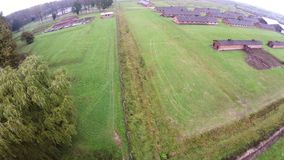 Aerial view of Auschwitz I - Birkenau, watch tower, gas chambers and fence stock video