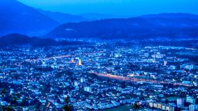 Austrian city and mountains by night. Aerial view of the Austrian city of Villach, with the Alps in background, long exposure night vew Stock Photos