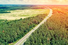 Aerial view of the autobahn. Passing through the forest and fields at sunset stock photography