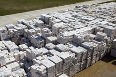 Aerial view of autoclaved aerated concrete blocks, both defective and good, on pallets, stored at factory warehouse.  stock photos