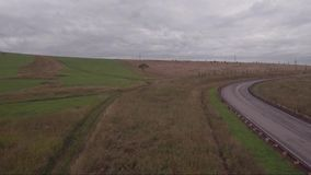Aerial view of autumn country road with cars. Logistics and transportation concept stock video