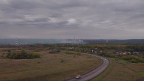 Aerial view of autumn country road with cars. Logistics and transportation concept stock footage