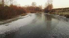 Aerial view of autumn icy river at sunset stock footage