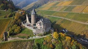 Flight arpund Stahleck Castle and Bacharach, Germany. Aerial view of autumn Rhine valley, Bacharach town and Stahleck Castle, Germany stock footage