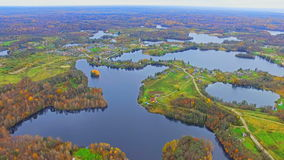 Aerial view of the autumn river and forest stock footage