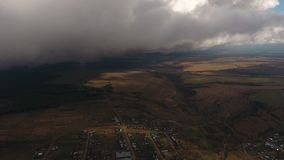 Aerial view of an autumn valley. With village and fields stock footage