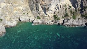Aerial view of azure coast of the Adriatic Sea in Montenegro with emerald transparent water, rocks and cliffs in 4k stock video footage