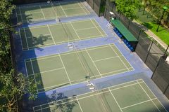 Aerial view of badminton courts with surrounded green trees.  Royalty Free Stock Photos