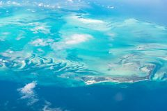 Aerial view of the Bahamas Berry Islands, stunning islands, sand bars and coral reefs with turquoise sea, shot from aeroplane.  royalty free stock photography