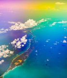Aerial view of the Bahamas, psychedelic effect. Aerial view of the Bahamas, stunning islands, sand bars and coral reefs with turquoise sea, shot from aeroplane Royalty Free Stock Images