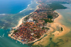 Aerial view on Bali. Aerial view of Nusa Dua beach on Bali showing roofs of many hotels and restaurants Stock Image