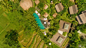 Aerial view of balinese village. Aerial view of swimming pool in a typical villas stock images