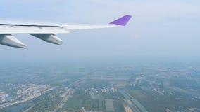 Departure from Bangkok. Aerial view Bangkok, capital of Thailand, view fom departing aircraft stock video footage