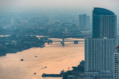 Aerial view of Bangkok and Chao Phraya river on dusk. Aerial view of Bangkok and Chao Phraya river in evening haze on dusk Stock Photo