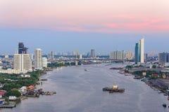 Aerial view of Bangkok city at Chao Phaya riverfront and bridge Royalty Free Stock Photography