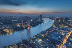 Aerial view Bangkok city downtown and river curved Royalty Free Stock Photos