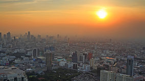 aerial view of Bangkok cityscape at sunset Stock Image