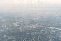 Aerial view of Bangkok metropolis and Chaophraya river on haze day. Aerial view of Bangkok metropolis and Chaophraya river. Thailand Stock Photo