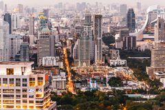 Aerial view of Bangkok modern office buildings, condominium in Bangkok city downtown at the dusk. With city and traffic lights.  Royalty Free Stock Image