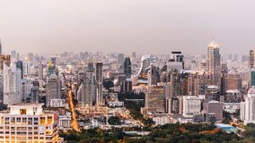 Aerial view of Bangkok modern office buildings, condominium in Bangkok city downtown at the dusk. With city and traffic lights.  Royalty Free Stock Photography