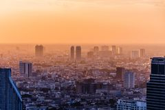 Aerial view of Bangkok modern office buildings, condominium in Bangkok city downtown at the dusk. With golden sunlight. Aerial view of Bangkok modern office Royalty Free Stock Photos