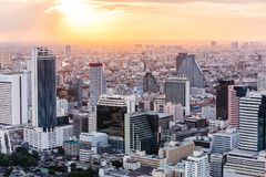 Aerial view of Bangkok modern office buildings, condominium in Bangkok city downtown at the dusk. With golden sunlight.  Royalty Free Stock Photo