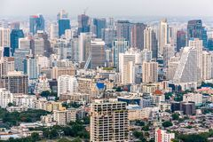 Aerial view of Bangkok modern office buildings, condominium in Bangkok city downtown at the dusk. With golden and purple sky.  Stock Image