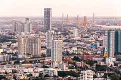 Aerial view of Bangkok modern office buildings, condominium in Bangkok city downtown at the dusk. With golden and purple sky.  Stock Photos