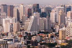 Aerial view of Bangkok modern office buildings, condominium in Bangkok city downtown at the dusk. With golden and purple sky.  Royalty Free Stock Image