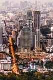 Aerial view of Bangkok modern office buildings, condominium in Bangkok city downtown at the dusk. With city and traffic lights.  Royalty Free Stock Images