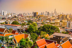 Aerial view of Bangkok monastery and modern office buildings stock photos